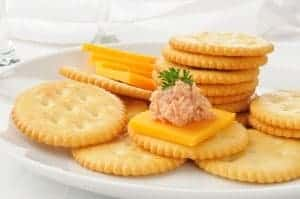 Deviled ham and cheese on crackers