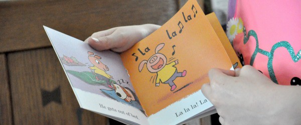 Little girl reading lalalala