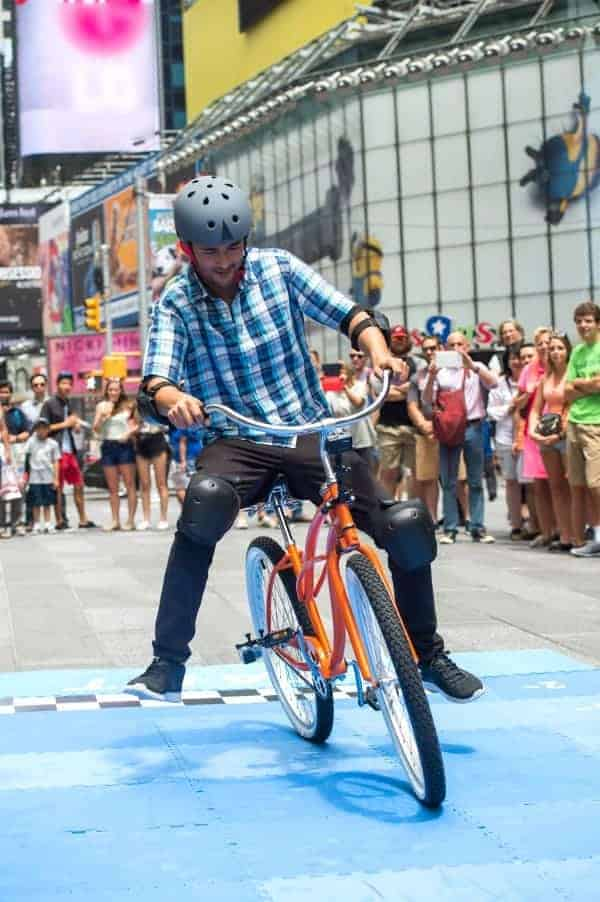 NEW YORK CITY, N.Y.- Jason Silva riding the Backwards Bike in front of a crowd in Times Square. (Photo Credit: NG Studios/Scott Gries)