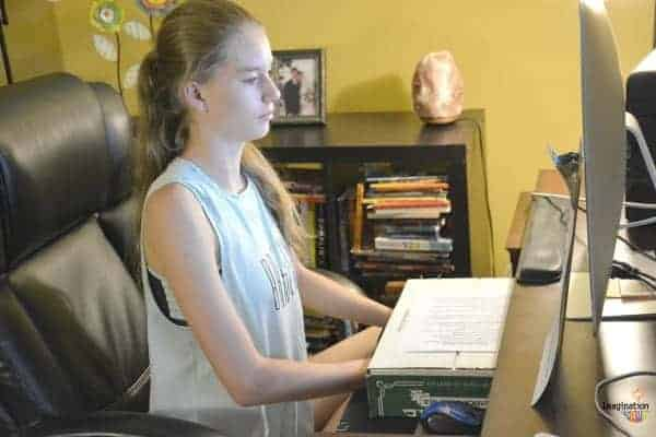 touch typing for kids -- notice that the keyboard is covered