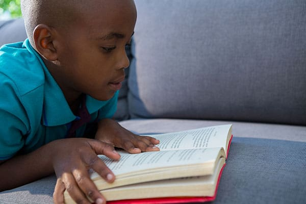 boy reading a chapter book